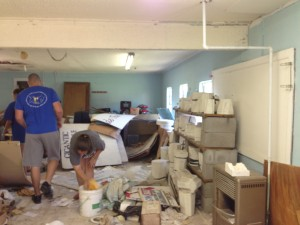 Nate Saint and intern, Brittney Mansel, cleaning house